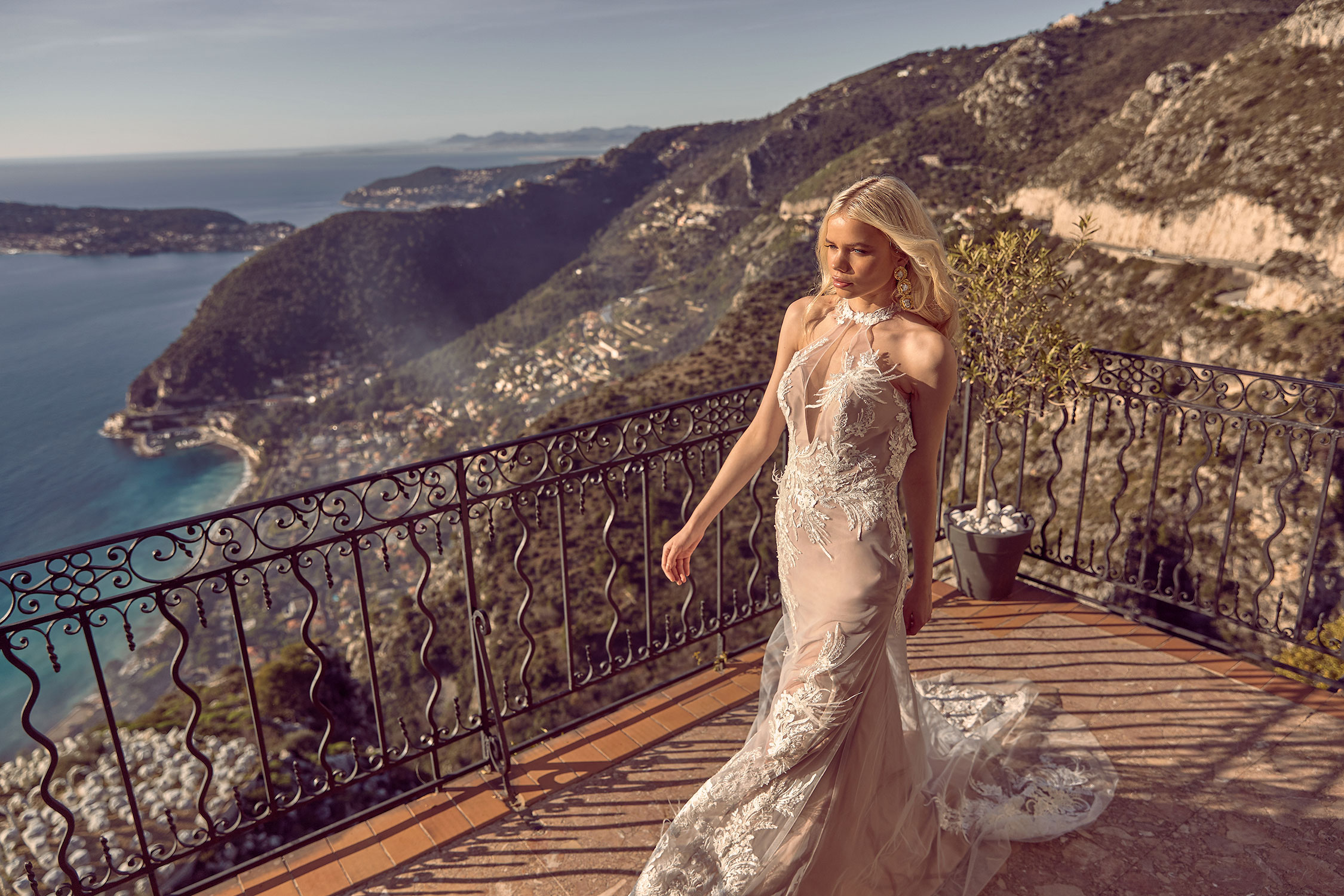 Havana Ml3819 Fitted Tulle And Lace Gown With Plunging Neckline And Halter Neck Design Low Back Feather Details And Front Side Split Wedding Dress Madi Lane Bridal5