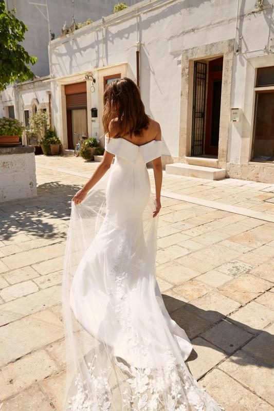 Miles Ml12885 Crepe Gown With Off The Shoulder Straps Zip Up Back With Detachable Cape Wedding Dress Madi Lane Bridal7