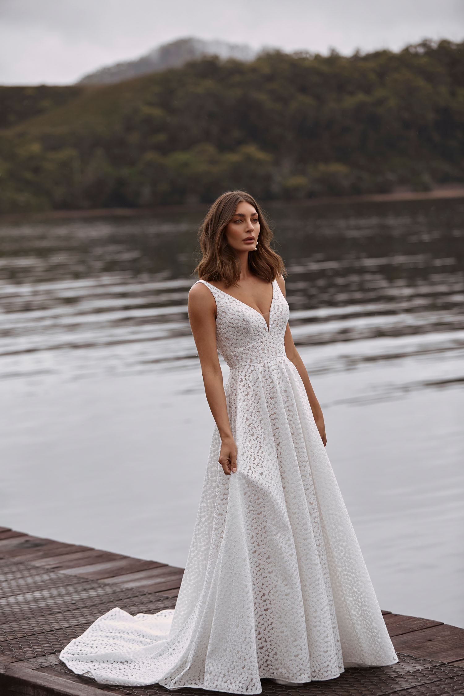 Clara Ml20038 Full Length A Line Gown With Deep V Neckline Fitted Waist All Over Embroidered Lace V Back And Zipper Closure Wedding Dress Madi Lane Bridal 1